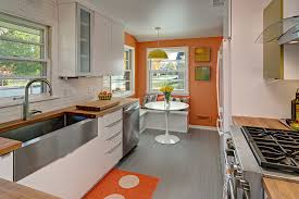 mid century modern kitchen midcentury kitchen photo in minneapolis with a farmhouse sink flat panel cabinets anatomy eat kitchen