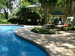 Swimming Pool:Incredible Backyard Pool Landscaping With Neutral Water  Fountain And White Umbrella Awesome Backyard