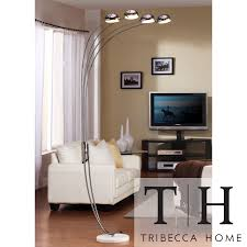 Brighten your living room with this modern chrome floor lamp. The four  shades are operated
