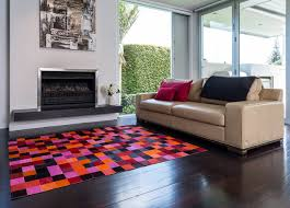 colourful cowhide patchwork rugs pixel reds oranges modern living room