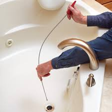 a simple plumbing snake like this one will clear most blockages stuck in the drain