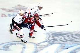 u s department of defense photo essay  washington s troy brouwer center gets squeezed out of a puck chase by chicago s marian