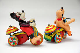 Tin toy up vintage wind