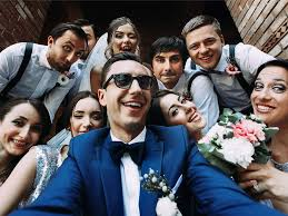 Image result for people taking pictures of everyone at a wedding