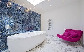large modern bathroom with freestanding bath and sofa