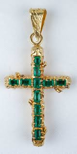 simple 18k gold cross pendant of 18k yellow gold and emerald cross pendant