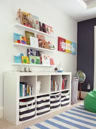 Great storage ideas for a kids room - the Expedit Bookcase + striped bins  are a match made in heaven!