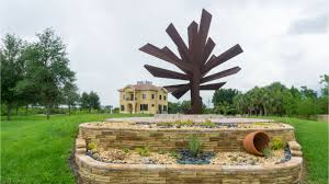 steel palm is signature sculpture of the peace river botanical sculpture gardens in