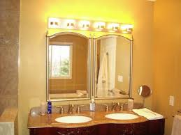 appealing light fixtures for bathroom small lighted shades light up on big mirror of yellow wall