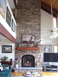 what is a direct vent fireplace. A Gracefully Arched Mendota Greenbriar M-50 Direct Vent Gas Fireplace Surrounded In Stone, With Wood Slab Mantel What Is