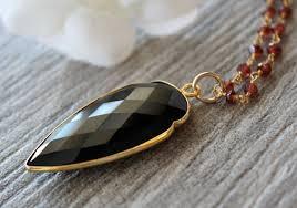 large garnet and black onyx arrowhead pendant necklace red garnet rosary style arrow head necklace long necklace bygerene