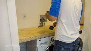 the shelving for this diy laundry room was made out ¾ plywood from home depot