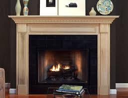 decorating fireplace mantels in modern art way wooden fireplace mantels with flowervase and plate ornament