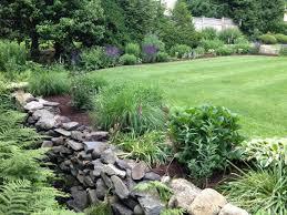 lawn care around beautiful pond