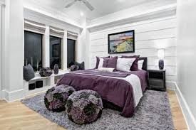 ... Lovely blend of various shades of purple and violet set against grey  walls in the bedroom