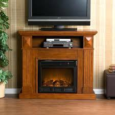 corner electric fireplace tv stand stylish wooden unit featuring leather storage ottoman canada