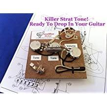 amazon com tone man guitar stratocaster fender prewired wiring harness kit eric johnson set up wired for bridge tone control 1uf vintage pio tone cap