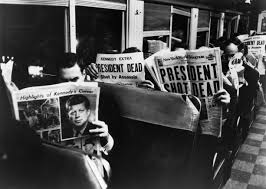 why the public stopped believing the government about jfk s murder  commuters reading of john f kennedy s assassination 1963 credit carl mydans