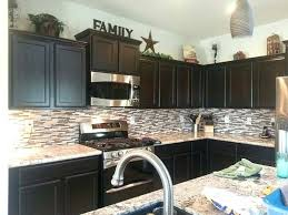 decorations for on top of kitchen cabinets decor top cabinets kitchen decorating above kitchen cabinets