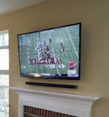 hanging a flat screen tv over a gas fireplace perfect tv mounting service home theater installation fort mill sc