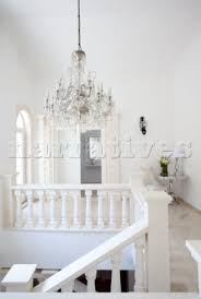glass chandelier hangs above staircase in hallway of holiday villa republic of turkey