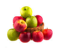 green and red apples in basket. fresh red and green apples in a wooden basket stock images