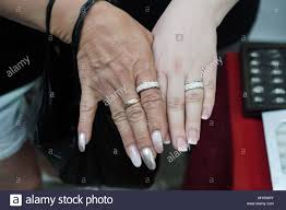 germany hohenwutzen picture of friends jacqueline schwerdter and anne froehlich showing their rings at a jewelry stand at the polish market