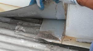 leaking roof repair at chimney flashing on sydney metal roof