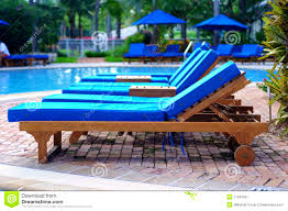 winning chaise lounge chairs by the pool stock image target full size