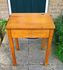 vintage classic wooden school desk it of course has a front opening lid and ink well as well as marks knocks and wears that you would expect