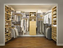 closet designs with multiple hangingclothes areaany shelves also drawers plus white basket boxes over varnished hardwood floor without door