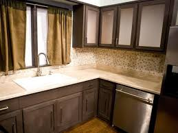Pre Fab Kitchen Cabinets Black Wooden Kitchen Cabinet With White Countertop And Sink On