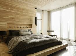 apartment bedroom ideas. modern apartment bedroom ideas with wooden bed and headboard wall decor