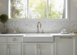 shallow a sink with wall mount brass pivot faucet