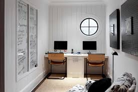 betty burgess design modern cottage office with white vertical tongue and groove walls wall to wall built in desk for two leather office chairs