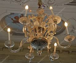 crystal chandelier made with murano glass on the ceiling of a villa photo by chiccododifc