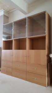 ikea besta birch display cabinet with three glass doors