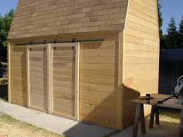 make sliding barn doors using skateboard wheels diy rolling shed door