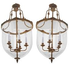 two french modern neoclassical style brass and blown glass chandeliers lanterns for