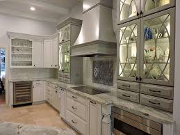the kitchen cabinets are kraftmaid designed with marquette door styles two color finishes were used maple dove white with cocoa glaze finish for the