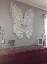 721d1c4e8ab888a46eb130c48a8eefbc.jpg 600×800 pixels   Diy angel wings,  Angel decor, Angel wings wall