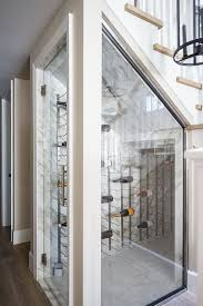 a small yet comfy wine cellar clad with marble and with a large metal wall