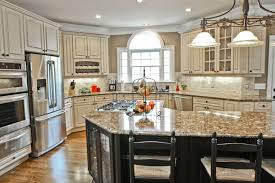 antique white kitchen cabinets with granite