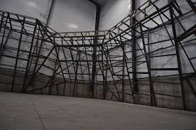 the entire climbing wall framework and surface paneling will be manufactured using welded steel surface panels will be prefabricated using 2 angle
