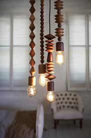 wood beads in various shapes and sizes make up these pendant lights