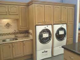 cabinets in laundry room. laundry room concept by kraftmaid cabinetry traditional-laundry-room cabinets in e