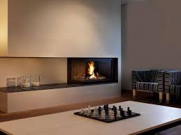 asymmetrical fireplace design with open hearth perfect for dimplex optimyst electric insert