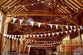 rustic wedding lighting. festoon lights for a barn wedding rustic lighting