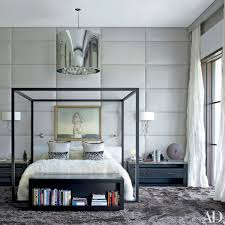 the master bedroom s walls are upholstered in an Élitis linen and a moooi light fixture