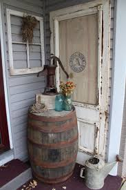 primitive outdoor decorating whiskey barrel old door feed sack window frame